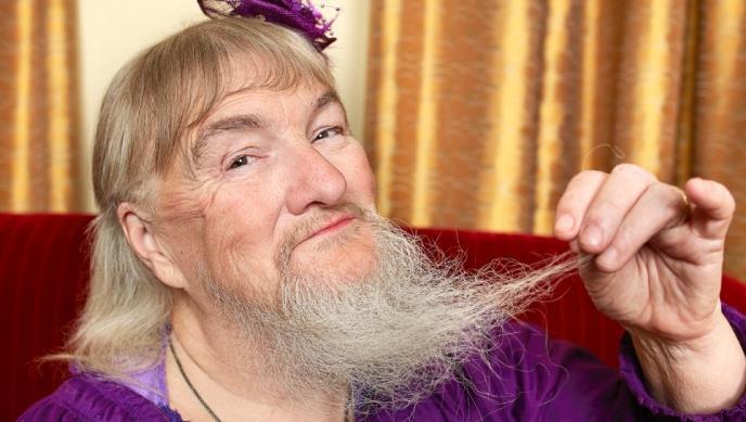 из за чего растет борода у женщин
