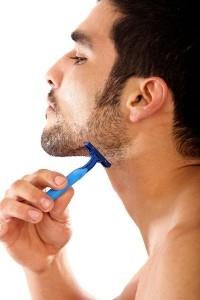 bigstockphoto_man_shaving_his_beard_2973600.s600x600_x200_40951
